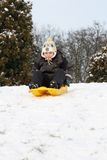 Child sledding - winter fun Stock Image