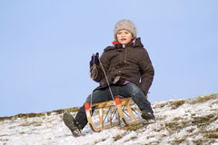 Child on sledge Stock Images