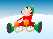 Child on a sledge Royalty Free Stock Image