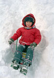 Child sledge on snow Royalty Free Stock Photography