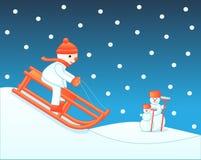 Child sledging downhill Stock Photo