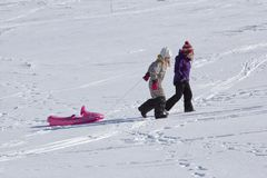 Child sledging on high mountain Stock Photography
