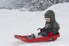 Child sledging Stock Images
