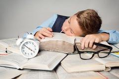 Child Sleep on Books, Tired Student Kid Studying, Lying on Book. Child Sleep on Books, Tired Student Kid Studying, Face Lying on Book near Alarm Clock, Children royalty free stock image