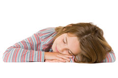 Child sleeping. Girl lying on the ground isolated on white Royalty Free Stock Photo