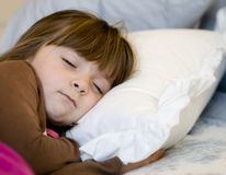 Child sleeping in bed Stock Images