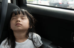 Child sleeping in the car Stock Images