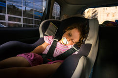 Child sleeping in car seat royalty free stock photography