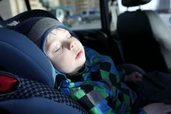 Child sleeping in car seat Royalty Free Stock Photo
