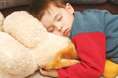 The child sleeping in clothes Royalty Free Stock Image