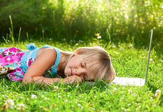 Child sleeping on computer outdoor Stock Images
