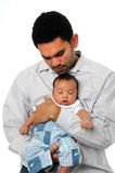 Child Sleeping in Father's Arms royalty free stock photo