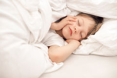 Child Sleeping In Bed Royalty Free Stock Images