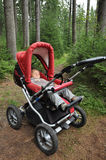 Child sleeping in pram Royalty Free Stock Photography