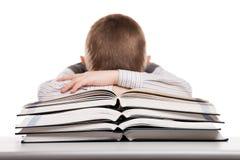 Child sleeping on reading books Stock Images