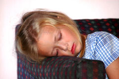 Child sleeping on sofa Royalty Free Stock Photos