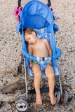 Child is sleeping in the stroller Stock Images