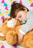 child sleeping with teddy bear Stock Images