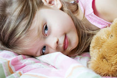 Child sleeping with teddy bear Stock Photos
