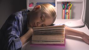 Child Sleeping, Tired Eyes Girl Portrait Studying, Reading, Kid Learning Library royalty free stock image