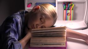 Child sleeping, tired eyes girl portrait studying, reading, kid learning library.  stock video