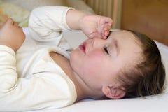 Child sleeping or waking Royalty Free Stock Photos