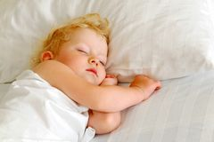 Child sleeps in bed Royalty Free Stock Photos