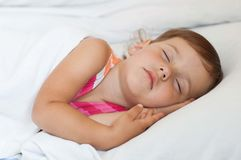 The child sleeps in bed Royalty Free Stock Photos