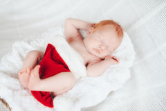 Child sleeps in a hat of Santa Claus Royalty Free Stock Image