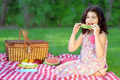 Child with slice watermelon at picnic Stock Photos