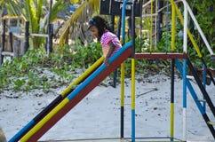 Child on a slide Stock Photo
