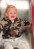 Child on a slide Stock Image