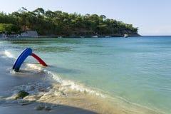 Child slide on Aliki beach on Thasos. Photo of a child water slide on Aliki beach on Thasos island Royalty Free Stock Image