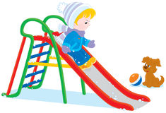 Child on a slide. Little boy or girl sliding down Royalty Free Stock Image