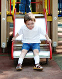 Child on slide outdoor in park. Royalty Free Stock Photos