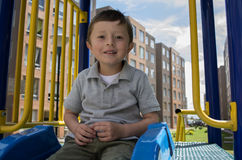Child on slide in an outdoors playground. Royalty Free Stock Images