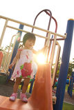 Child on a slide in playground Royalty Free Stock Photography