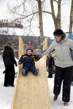 Child slide on winter playground Royalty Free Stock Photography
