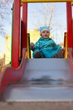 The child slides a children's hill Stock Photography