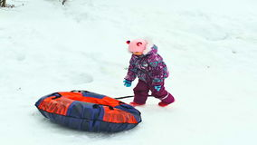 Child slides on snow tubing. Winter stock footage