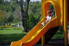 Child sliding Stock Photos