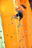 Child sliding down the  climbing wall. 8 years old girl  child sliding down the  climbing wall Royalty Free Stock Photos