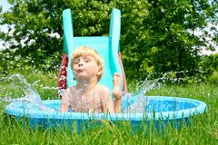 Child Sliding into Pool Royalty Free Stock Photos