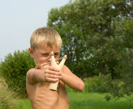 Child with a slingshot. Stock Photos