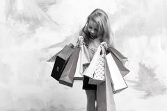 Child or small girl with shopping bag or present pack Stock Images