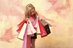Child or small girl with shopping bag or present pack. On colorful background, holiday and party celebration stock photo