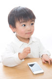 Child and smart phone Royalty Free Stock Photography