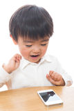 Child and smart phone. The child who plays with a smart phone Stock Images