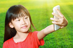 Child with smartphone Royalty Free Stock Photo