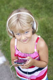 Child with smartphone and headphones Royalty Free Stock Photography